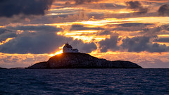 Kalsholmen (jarnasen) Tags: fujifilmxt1 xt1 xc50230mmf4567 50230mm telezoom handheld freehand sunset sun lighthouse island sky backlight nature nordiclandscape nordic norway sea seascape outdoor ocean atlantic waves midnight atmosphere mood fishing scandinavia