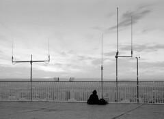 High level meditation (rob kraay) Tags: horizon ironfencing robkraay blackandwhite skyscraper antenna people montparnassetower cloudysky viewoverparis roof bw