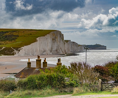 Cuckmere Haven... (Aleem Yousaf) Tags: cuckmere haven beach coast guard cottages chimney white cliffs chalk sussex heritage pebble secluded english countryside coastline erosion eastbourne seven sisters sand rocks pools sedimentary channel granite nikon d850 landscape clouds sky south downs seaside seaford photowalk england united kingdom people frame digital camera world scale walk photo