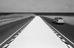 The road ahead (rob kraay) Tags: car roadmarking robkraay blackandwhite roadmarkingposts horizon cloudy dyke sandmountain roadsigns licenceplate sandyroadside bw maasvlakte