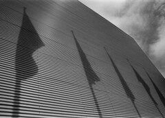 Imagination 3 (rob kraay) Tags: factoryfacade clouds robkraay blackandwhite aluminiumbuilding flag cloudysky bw