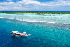 Tropical cruise (icemanphotos) Tags: cruise boat lagoon summer travel sail island tropical sea palms sky exotic maldives