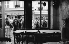 Sightseeing (rob kraay) Tags: pub montmartre robkraay blackandwhite chair window people table doorframe customer backpack tour paris sightseeingspots windowframe pubinterior lunchroom bw
