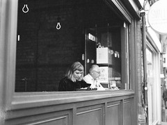 Thinking Lady (Foto John) Tags: bronica bronicaetrs etrs zenzanoneii75mmƒ28 645 mediumformat 6x45 film kodaktmax400 120 rollfilm monochrome bw blackwhite blackandwhite streetphotography people woman man pub window lightbulbs crouchend london uk