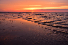Orange sunset over the Baltic sea (Pavel's Snapshots) Tags: latvia jurmala baltic sea ocean water sand beach shore coast waves orange sun reflection cloudy wild nature landscape nikon nikkor kit d750 vivid colorful travel destination weekend evening sunset summer 35mm