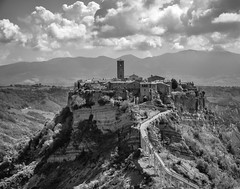 The Dying City (Ann Kunz) Tags: italy tuscany travel dyingcity landscape blackandwhite hilltown civitabagnoregio europe etruscan fortress