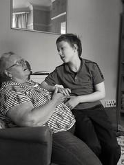 That crumble and custard moment (daveandlyn1) Tags: nanna x grandson cuddle monochrome blackwhite people indoors manchester pralx1 p8lite2017 huaweip8 smartphones psdigitalcamera cameraphone