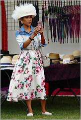 Does it suit me? (donbyatt) Tags: miltonkeynes campbellpark thaifestival people candids fashions