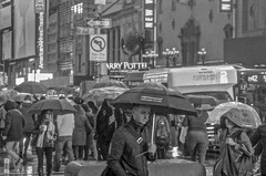 Rainy day in the city. (Capitancapitan) Tags: rain train manhattan times square neury luciano pop rock urim y tumim black white photography street monochrome nyc new york city umbrella el mundo gira