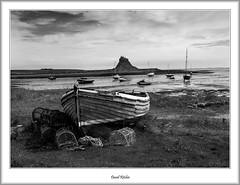 Beached Boat at Lindisfarne (flatfoot471) Tags: 2008 england unitedkingdom holiday northumberland august lindisfarne coast beach northsea holyisland farneislands summer castle boats blackwhite holyisle