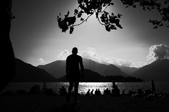 A day at the lake (stefankamert) Tags: daysatthelake lake sun clouds landscape people man water mountains lakecomo italy stefankamert ricoh gr grii ricohgrii 28mm tones mood grain silhouette noir noiretblanc colico