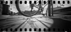 2417 Spokes. (Monobod 1) Tags: ondu 135 panoramic expired ilford hp5 rodinal pinhole lensless epsonv800