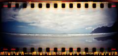 Caleta de Famara (Ulla M.) Tags: panorama beach strand analog lomo lomography toycamera kreta lanzarote analogue analogphotography mediterraneansea wellen selfdeveloped filmphotography mittelmeer sprocketholes filmisnotdead caletadefamara selbstentwickelt filmshooter canoscan8800f sprocketrocket tetenalcolortec umphotoart