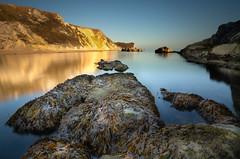 Man o war bay (paullangton) Tags: bay manowar jurassic coast dorset sunset long exposure lee sky rocks headland beach seaweed shadow warm golden blue landscape seascape durdle calm heritage