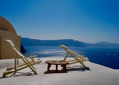 Seats with view (lesleydugmore) Tags: oia europe greece greekisland chair view mountains sea water blue sky ocean picturesque tranquil beautiful scenic travel aegeansea cyclands cyclandsislands outside outdoors peaceful tistheseason