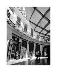 Valencia 13 (BLANCA GOMEZ) Tags: spain valencia bw blackwhite light shadows textures shapes silhouettes urban arquitectura architecture arquitecto salvadorescrig plazaredonda shopping shops restaurants housing houses