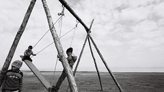 The Swing (Fab Photographe) Tags: kids game swing kyrgyzstan bnw film canoneos1v ilford ilfordhp5 voigtlander
