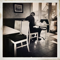 Table for one (Julie (thanks for 8 million views)) Tags: 100xthe2019edition 100x2019 image79100 iphonese kilmorequay bw hipstamaticapp candid window hww cafe man person table chairs shadow wexford monochrome songlyrics