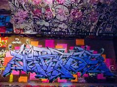 Overwriting Cubism (Steve Taylor (Photography)) Tags: marta schoolstart smomck cloud alien eye graffiti streetart tag colourful uk gb england greatbritain unitedkingdom london lensflare leakestreet
