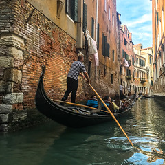 The Gondolier (Ann Kunz) Tags: italy people travel venice canals gondola europe water