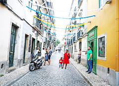 Wonder (kirstiecat) Tags: portugal lisbon people strangers colors colours red parent mother child boy son festive decorations street canon