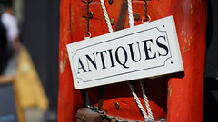 """""""Antiques"""" (Eric Flexyourhead) Tags: 169 sonyalphaa7 sonyselfe85mmf18 85mmf18 sonyfe85mmf18 city urban canada vancouver bc britishcolumbia gastown cordovastreet westcordova red detail sign shop store antiques antiquestore fragment shallowdepthoffield antiqueshop"""