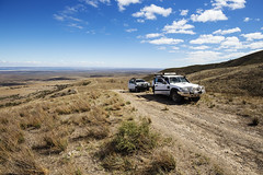Elevated View towards Port Augusta (oz_lightning) Tags: 4wd australia canon6d canonef1635mmf4lis sa spearcreek cars ecology grassland landscape nature road sky track water southaustralia southernflindersranges