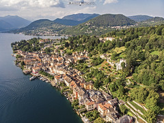 Orta San Giulio (Italy) (Andrea Moscato) Tags: andreamoscato italia montagna landscape light luce paesaggio sky shadow cielo clouds nature natura nuvole natural naturale view vista vivid day panorama lago lake water freshwater ombre yellow mountain city città boat piemonte orange house architecture architettura art overlook fly drone dji mavic air quadcopter blue dark deep buildings monte pier