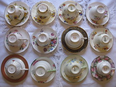 A Dozen Vintage Teacups (raaen99) Tags: teacups teacup saucer saucers pottery porcelain upsidedown freestyleonthefifth fotf fff flickrfamousfive english british browneyedsusan 1950s paragon paragonchina paragonbrowneyedsusan oldroyalbonechina violet violets violetbouquet 1895 1890s royaldoulton royaldoultontrixy trixy 1935 1930s windsor windsorbonechina dogwoodrose colcolugh colcloughchina colcloughbonechina englishrose roslynchina roslynbonechina minuet 1933 doublewarrant royalchrysanthemums chrysanthemums mums 1938 tulips 1926 1920s wedgwood queenofhearts 2008 handpainted hydrangea 1925 flora 1928 hydrangeas 1936 britishmade madeinengland collection collectable