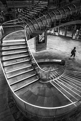 Bottom of the Stairs (paulbnashphotography (ARPS)) Tags: woman street streetphotography streetphoto streetlife pictasstreet visitbritain urban urbanphotography blackandwhite blackandwhitephotography blackandwhitephoto whiteandblack whiteandblackphotography whiteandblackphoto steps stairs staircase shoppingcentre shopping london londonbaby londonphoto londoncitycapital londoncity