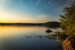Evening light (mabuli90) Tags: finland lake water forest tree rock nature landscape sunset sky clouds