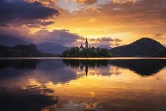 Magic island... (DaLiu_) Tags: bled slovenia lake sunrise church island water reflection mountain sun sky drama sunset