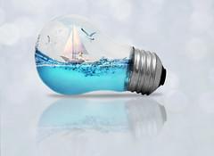 Lightship (Cat Girl 007) Tags: light lightbulb shawnharquail photomanipulation surrealism surreal fantasy ocean water mmmchallenge sailboat digitalart lightship whimsical