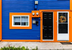 Bold (Karen_Chappell) Tags: orange blue house home nfld city urban jellybeanrow stjohns door window black wood wooden paint painted trim clapboard wreath canada canonef24105mmf4lisusm newfoundland eastcoast avalonpeninsula atlanticcanada street downtown building architecture color colour colourful colors colours multicoloured