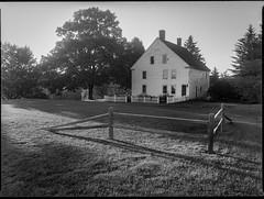 old homestead, near sunset, elongated shadows, Thomaston, Maine, Mamiya 645 Pro, mamiya sekor 45mm f-2.8, kodak TMAX 400, HC-110 developer, August 2019 (1 of 1) (steve aimone) Tags: homestead nearsunset whitepicketfence splitrailfence lawn shadows thomaston maine mamiya645pro mamiyasekkor45mmf28 mamiyaprime primelens 645 kodaktmax400 hc110developer 120 120film film mediumformat monochrome monochromatic blackandwhite
