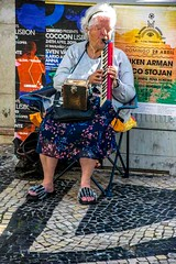 For One Euro a tune (Tony Shertila) Tags: nikon5300 architecture atlantic buildings city cruise europe lisbon portugal ship tourist worldcruise 201905021142420 music hawker musician portrait lady