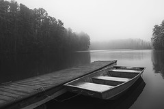 Solitude (Ann Kunz) Tags: boat blackandwhite fog lake lakelucas northcarolina landscape nature weather