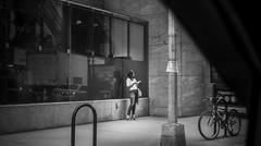 Waiting for her boyfriend while smoking a cigarette. (Capitancapitan) Tags: cigarette boyfriend manhattan nyc new york neury luciano urim y tumim el mundo gira streetphotography black white reflection camera pentax k500 k50 people urban