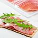 Sandwich with crispbread, dry-cured ham and arugula
