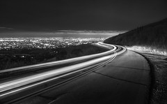 Listening to music on the way home (PeterThoeny) Tags: sanjose california usa siliconvalley sanfranciscobay sanfranciscobayarea southbay mthamilton road light lightstream sky landscape city citylight outdoor clear night longexposure monochrome blackandwhite sony a6000 selp1650 2xp raw photomatix hdr qualityhdr qualityhdrphotography fav200