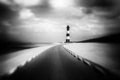 3443 (Elke Kulhawy) Tags: holland himmel netherland niederlande lensbaby lensbabycomposer landschaft leuchtturm lighthouse grain grainy blackandwhite bnw bw bnwbw bwphotographie black art abstract kunst korn küste coast clouds wolken
