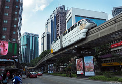 Monorail (peterphotographic) Tags: p8041185edwm olympus em5mk2 microfourthirds mft ©peterhall kualalumpur malaysia seasia asia urban city cityscape modern monorail transport building highrise street advertising advertisement