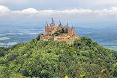 tophill Hohenzollern Castle and forest (arnaud_martinez) Tags: blue city germany hill hohenzollern ii jura lichtenstein neckar neuschwanstein sky summer swabian architecture bastion bavaria building castle chapel cinderella count domination emîre forest fortress fussen garden gate gothic hilltop historical house ludwig military mountain orange palace palacial revival river romances standing stones stuttgart touristic towers trees valley victorian war