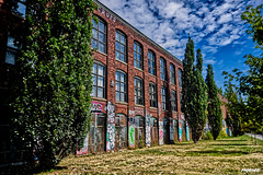 Old Structure In Montreal (Progseb) Tags: structure shadow green grass sky graffiti montreal cloud sharp clarity day outside building tree environment