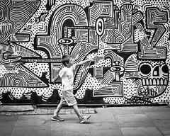IMG_1160706 (Kathi Huidobro) Tags: streetart reportage streetportrait streetphotography london eastlondon bricklane blackwhite bw monochrome urbanscene urban streetscene candid child graffitiart mural