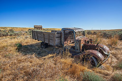 Halted Harvester (PNW-Photography) Tags: washington easternwashington rurex rural farming country farm farmhouse wheat wheatland rusty dusty rust dust abandoned lost truck vehicle auto automobile