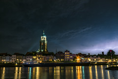 Lightning over Deventer (mesocyclone70) Tags: lightning city tower reflection river sky storm thunderstorm therebeastormabrewin