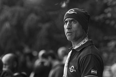 Startled (Frank Fullard) Tags: street trees ireland portrait irish white black monochrome face sport dark alarmed fan eyes noir expression startled candid crowd mayo athlete spectator blanc tugofwar frightened castlebar fullard frankfullard shave heard stubble