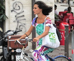 A street in Livorno (thomasgorman1) Tags: woman cyclist fashion bicycle bicyclist street livorno italy canon travel candid public streetshots streetphotos colors riding people