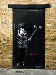 Rude Kids (Steve Taylor (Photography)) Tags: uk gb greatbritain selfie stick nophotographs dotmaster polkadots ponytail graffiti stencil streetart sticker black brown red white child kid girl england unitedkingdom london brick